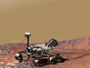 Un'illustrazione fotografica di un veicolo dotato di un laser che dovrebbe far parte del Mars Science Laboratory.